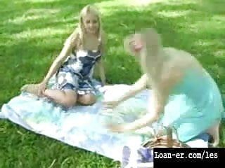 Sexy golden-haired lesbian babes have sex in a public park